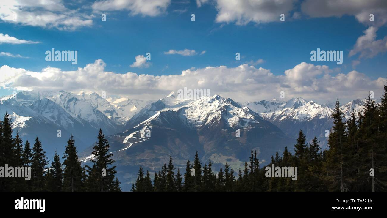 Snow disappearing in Austrian alps in the spring - Stock Image