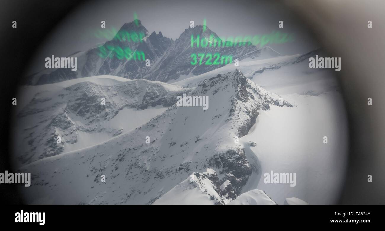 Analog Augmented reality displaying names and heights of mountains through a telescope - Stock Image
