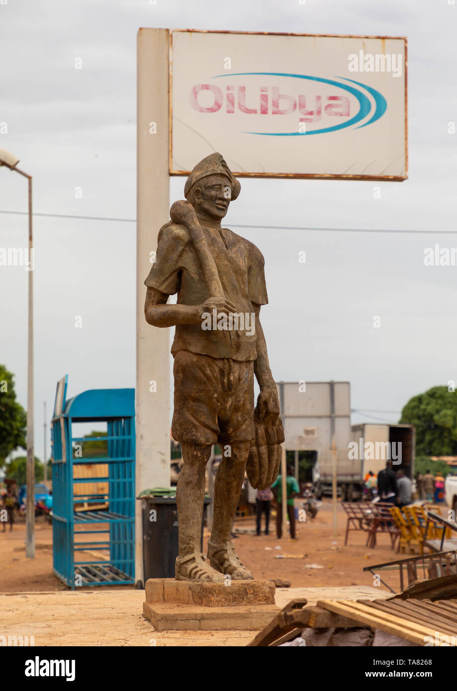 Statue in town at the entrance of a gas station, Savanes district, Kouto, Ivory Coast - Stock Image