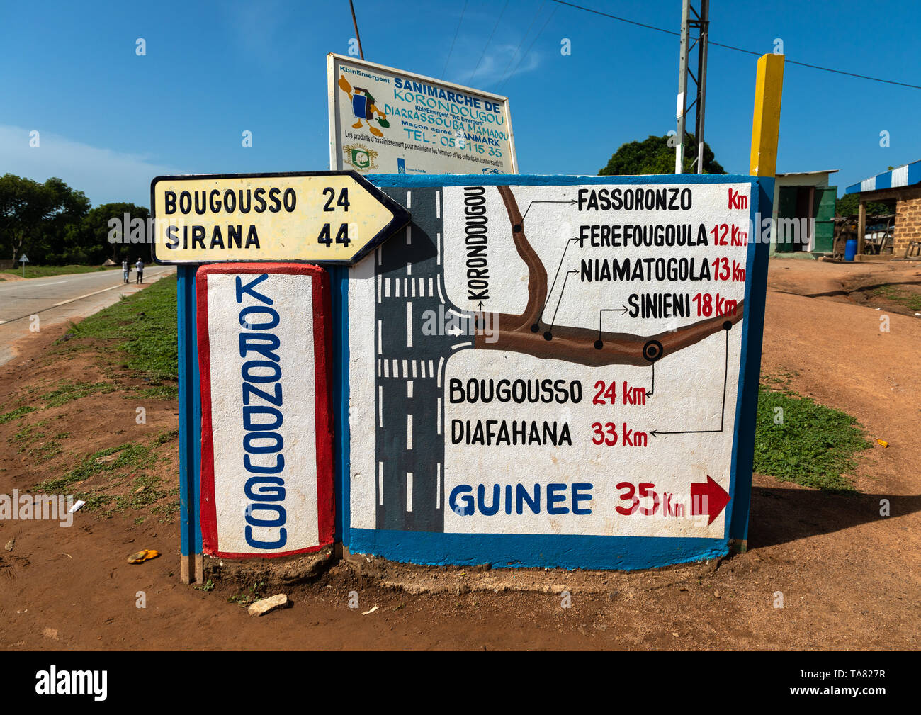 Arrows and signposts on the road, Denguélé, Korondougou, Ivory Coast Stock Photo