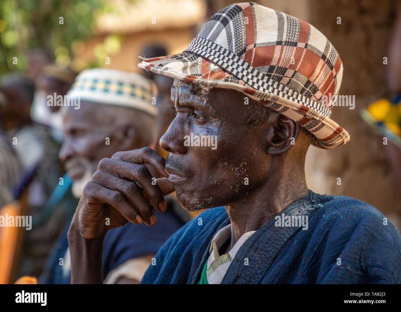 Senior Dan tribe chiefs during a ceremony, Bafing, Gboni, Ivory Coast Stock Photo