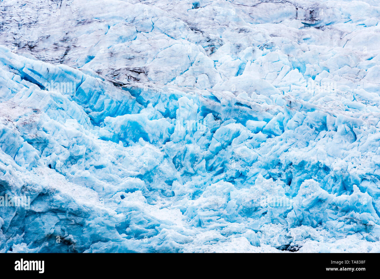 At the edge of the glacier Nordenskiöldbreen near Pyramiden, on the coast of Billefjord, Svalbard. Norway - Stock Image