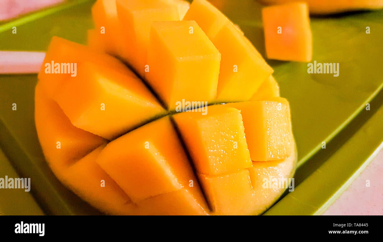 Mango fruit and mango cutting as cubes. - Stock Image