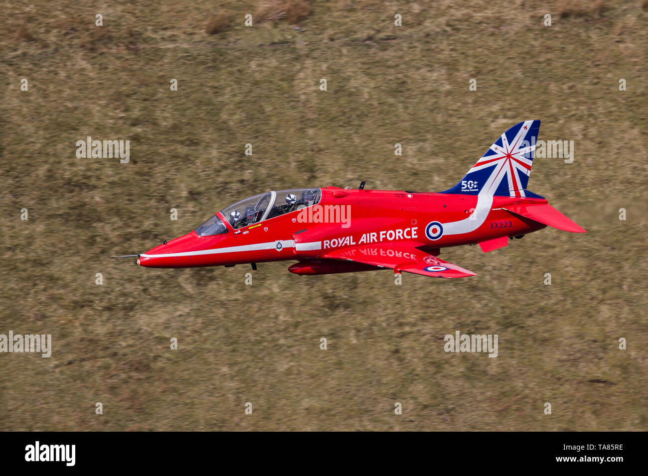 RAF Red Arrows Hawk T1 flying low level in the Mach Loop in Wales, UK Stock Photo