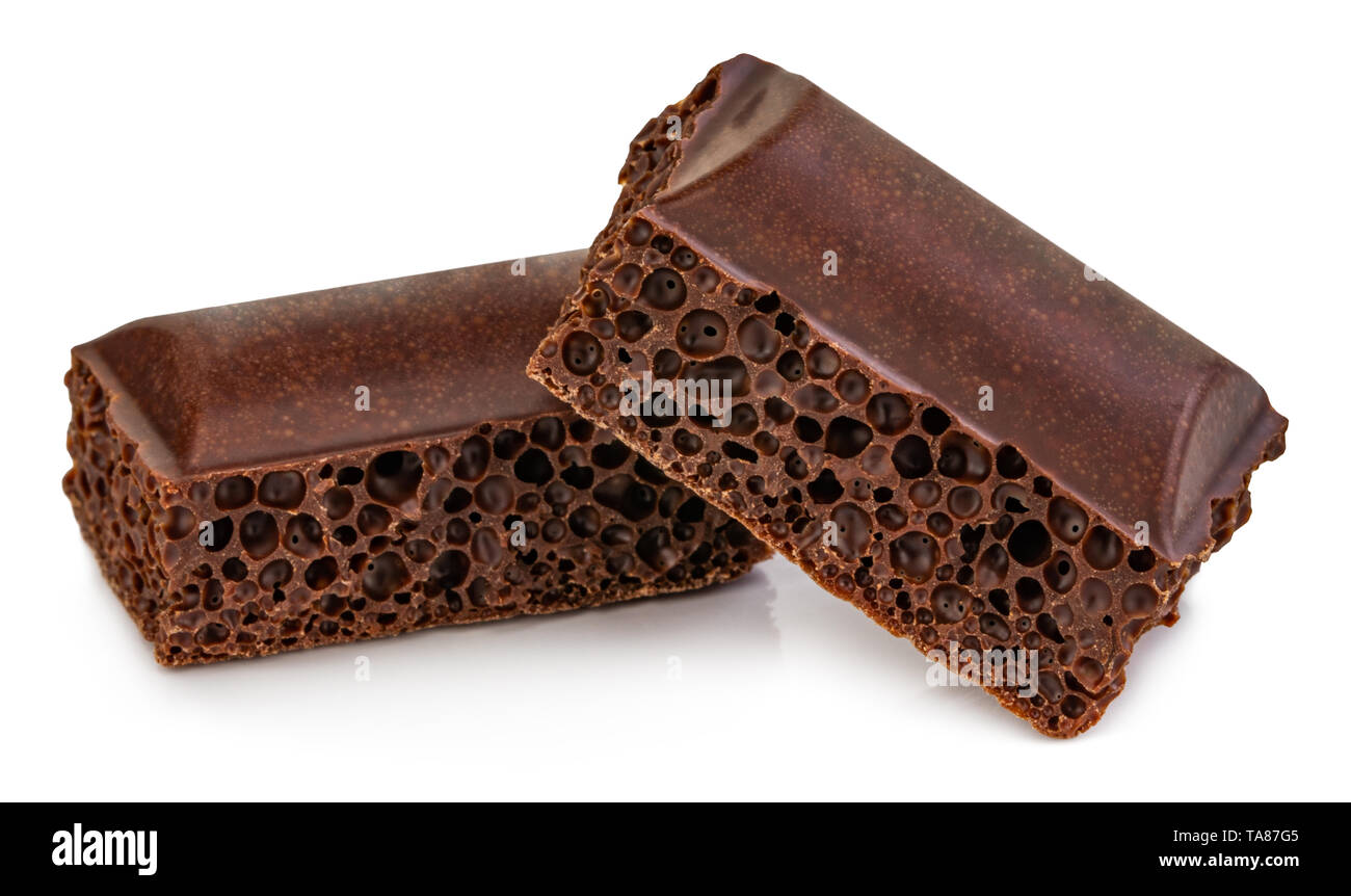 porous chocolate pieces isolated on white background. - Stock Image