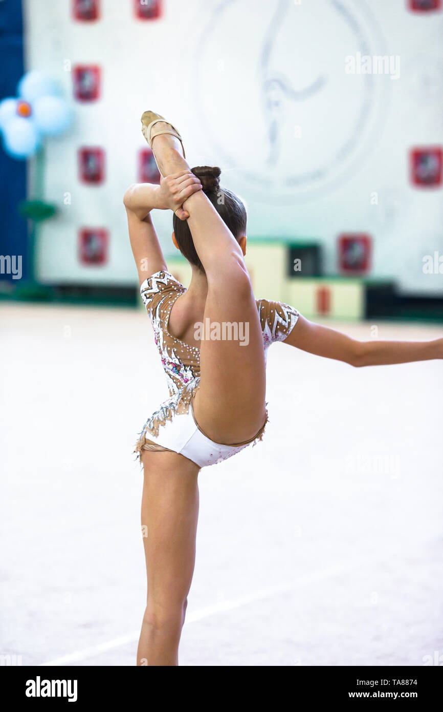 Little gymnast training on the carpet and ready for competitions - Stock Image