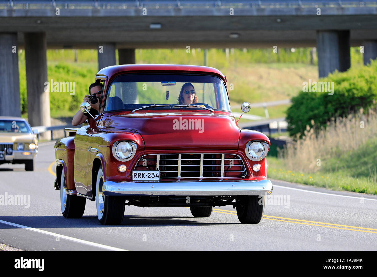 Salo, Finland. May 18, 2019. Woman drives a mid-1950s Chevy pickup, the male passenger is photographing on Salon Maisema Cruising 2019. - Stock Image