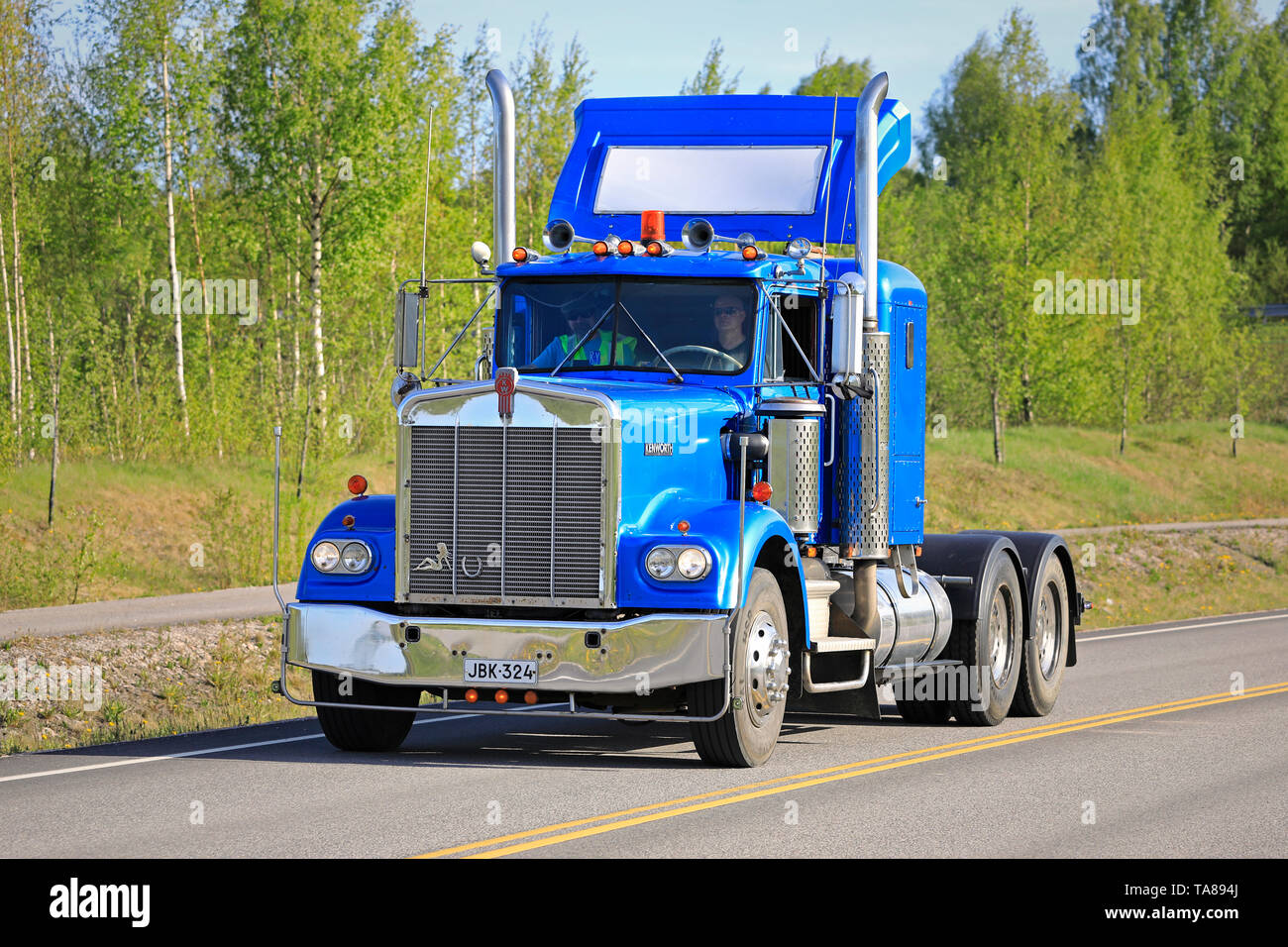 Salo, Finland. May 18, 2019. Blue Kenworth W900 truck tractor year 1978 on the road on the popular event Salon Maisema Cruising 2019. - Stock Image