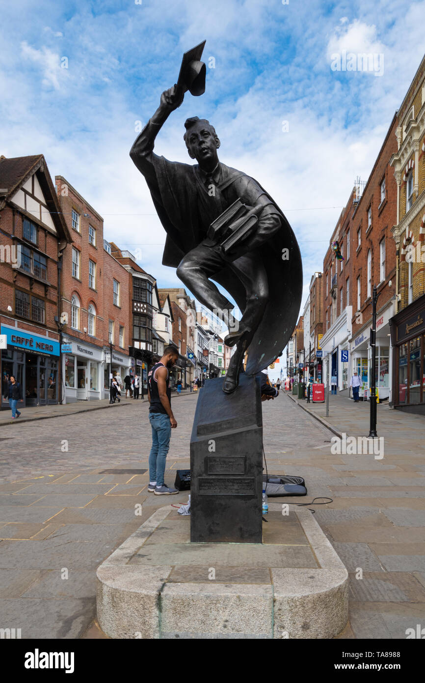 The Surrey Scholar bronze statue, by Allan Sly, on the High Street in Guildford town centre, Surrey, UK - Stock Image