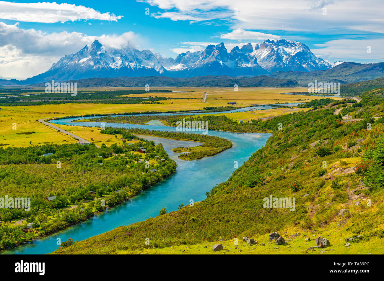 Majestic landscape of the Torres del Paine national park with the Cuernos del Paine peaks and the Serrano river near Puerto Natales, Patagonia, Chile. - Stock Image