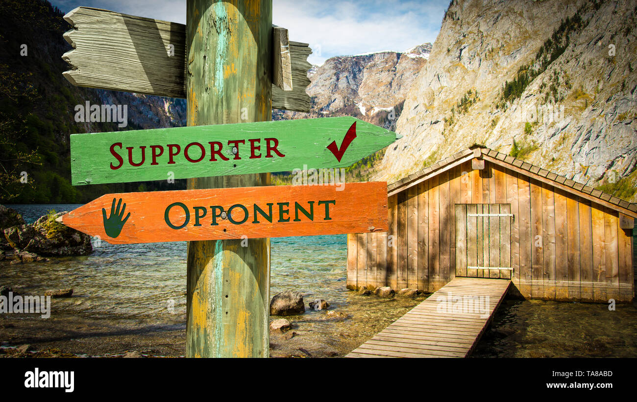 Street Sign the Direction Way to Supporter versus Opponent - Stock Image