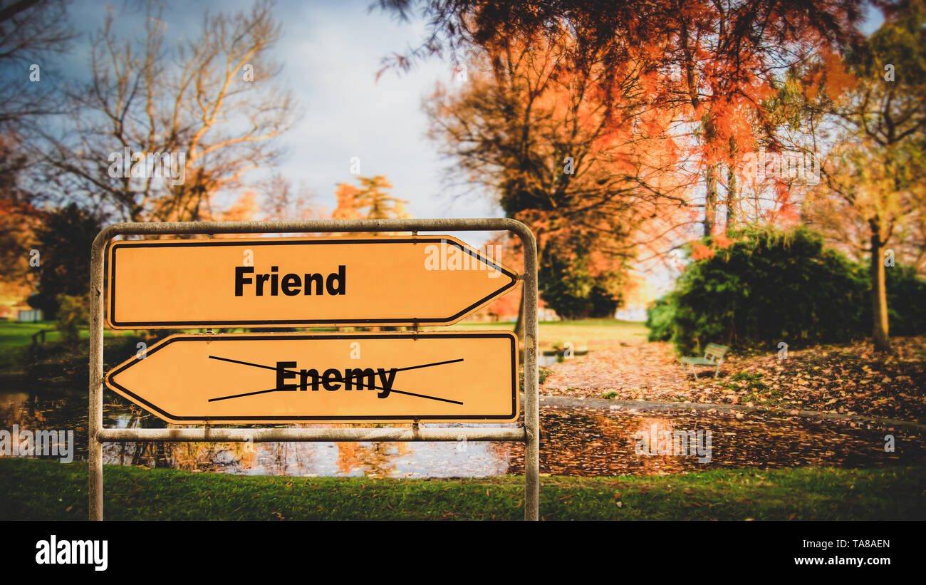 Street Sign the Direction Way to Friend versus Enemy - Stock Image