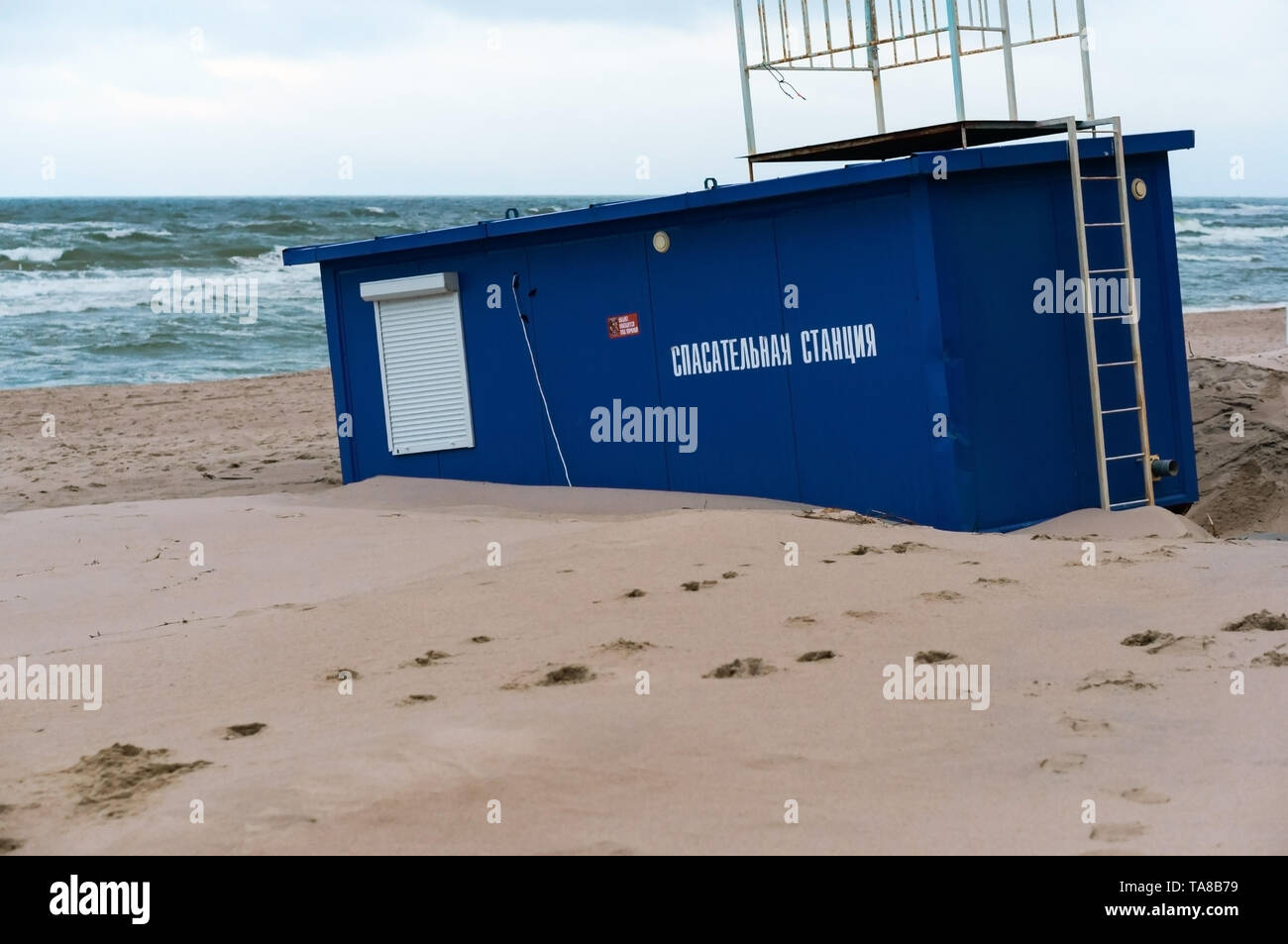 sea beach after a storm, rescue station in the sand, Yantarny village, Kaliningrad region, Russia, January 20, 2019 Stock Photo