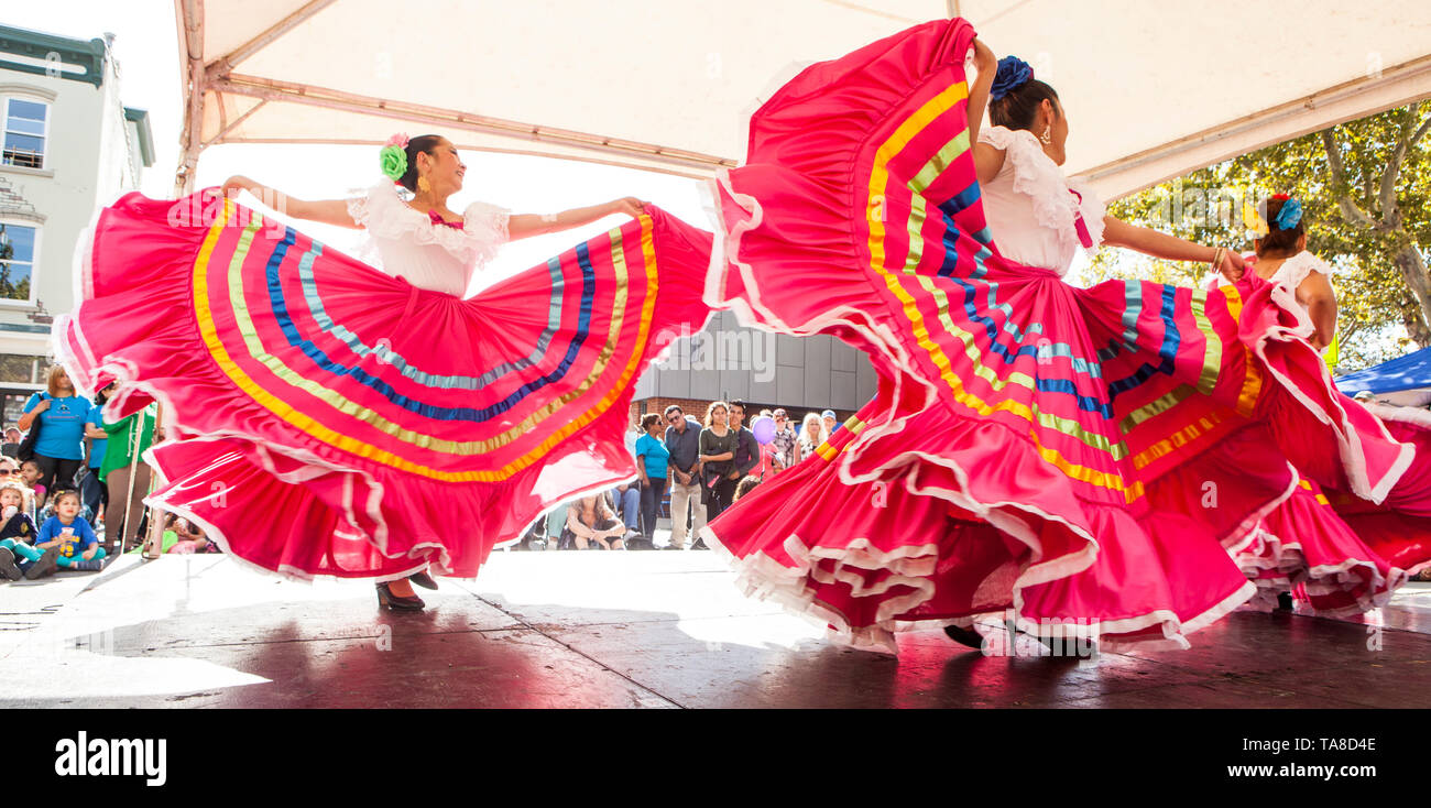 Group of Female Mexican Dancers with Flowing Pink Skirts Performing on Stage at Folk Festival, 'One River, Many Streams' Folk Festival, Part of Spirit of Beacon Festival, Beacon, New York, USA - Stock Image
