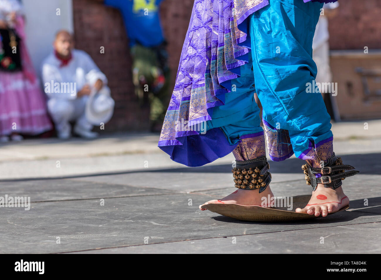 Painted Young Girls' Feet on Tray While  Doing Traditional Indian Dance, Ankle Bells, Blue and Purple Silk Costume, 'One River, Many Streams' Folk Festival, Part of Spirit of Beacon Festival, Beacon, New York, USA - Stock Image
