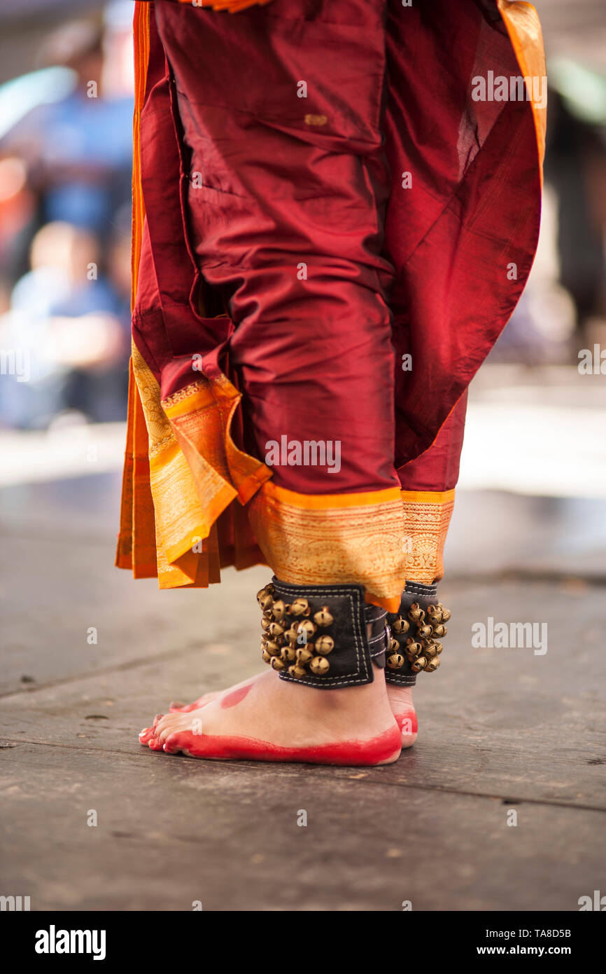 Painted Young Girls' Feet on Dance Floor While Doing Traditional Indian Dance, Ankle Bells, Red, Orange and Yellow Silk Costume,  'One River, Many Streams' Folk Festival, Part of Spirit of Beacon Festival, Beacon, New York, USA - Stock Image