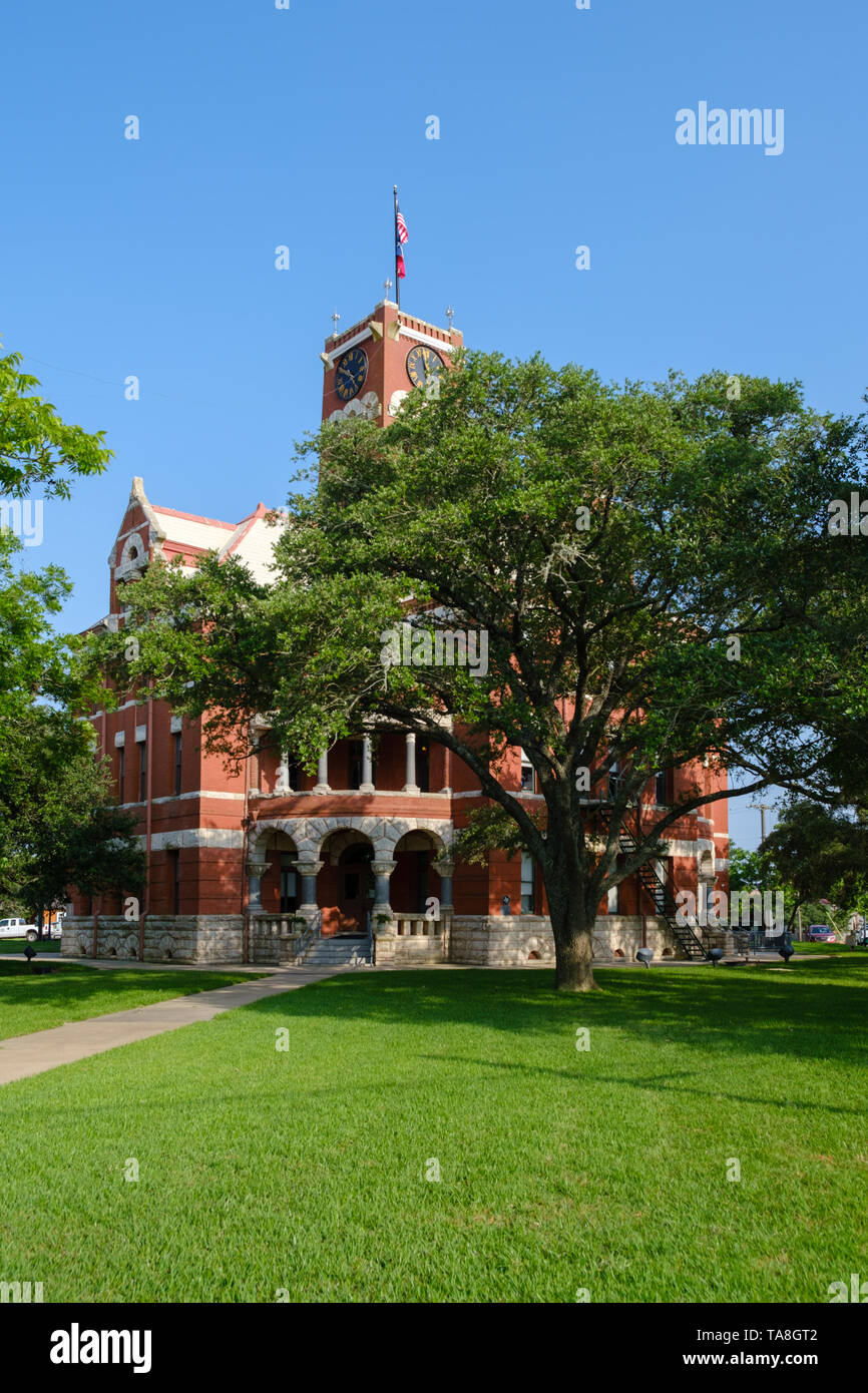 Town Square and Historic Lee County Courthouse built in 1899. Giddings City in Lee County in Southeastern Texas, United States - Stock Image