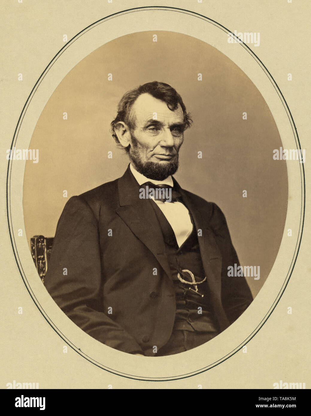 Half-Length Seated Portrait of Abraham Lincoln, Photograph by Anthony Berger, February 9, 1864 - Stock Image