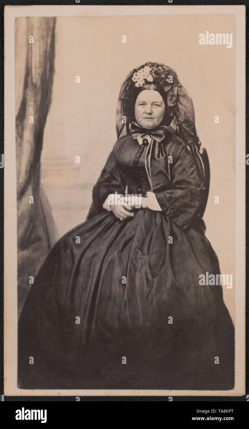 Full-Length Seated Portrait Mary Todd Lincoln in Mourning Attire after the death of her son, Willie in 1862, Photograph by Joseph Ward, possibly 1863, when she entered a period of half-mourning by evidence of a touch of white fabric at her wrists - Stock Image