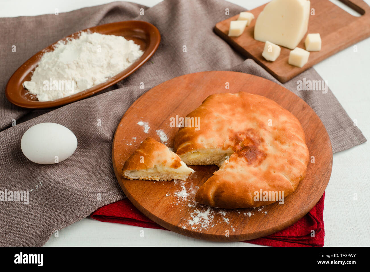 Cottage cheese traditional Russian pie with ingredients. Home cooking food photography in warm tones. - Stock Image