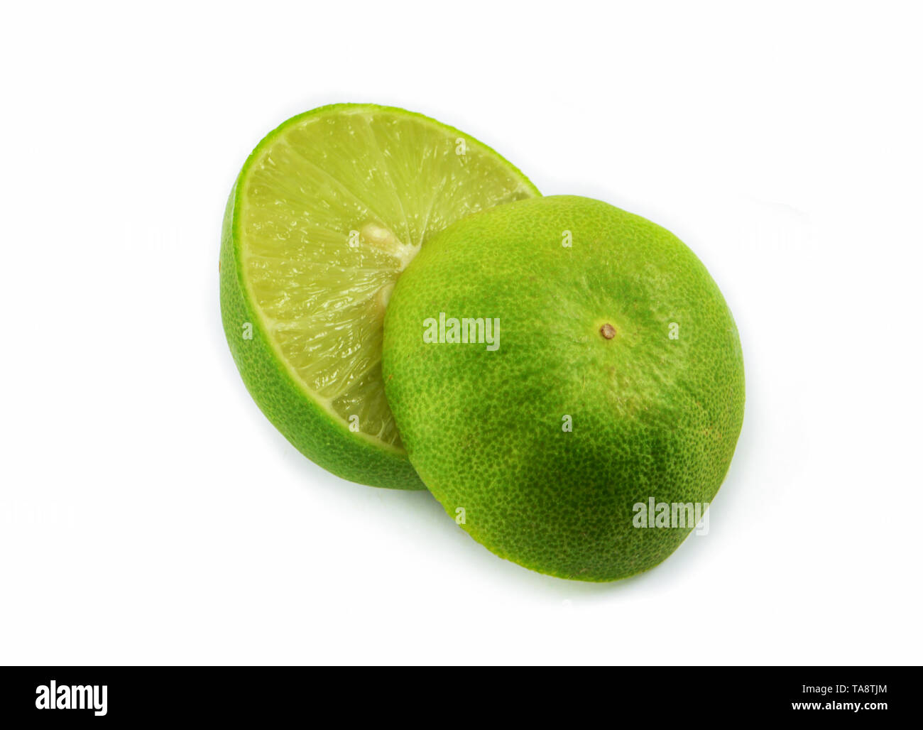 lime slice isolated / Fresh green limes slice half lemon on white background - Stock Image