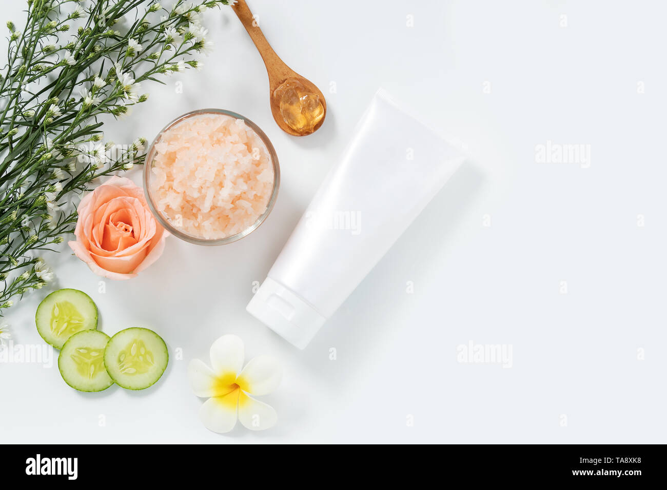 skin care concept. flat lays of skincare remedies style in white squeeze tube package with blank label and salt spa in glass bowl with natural materia Stock Photo