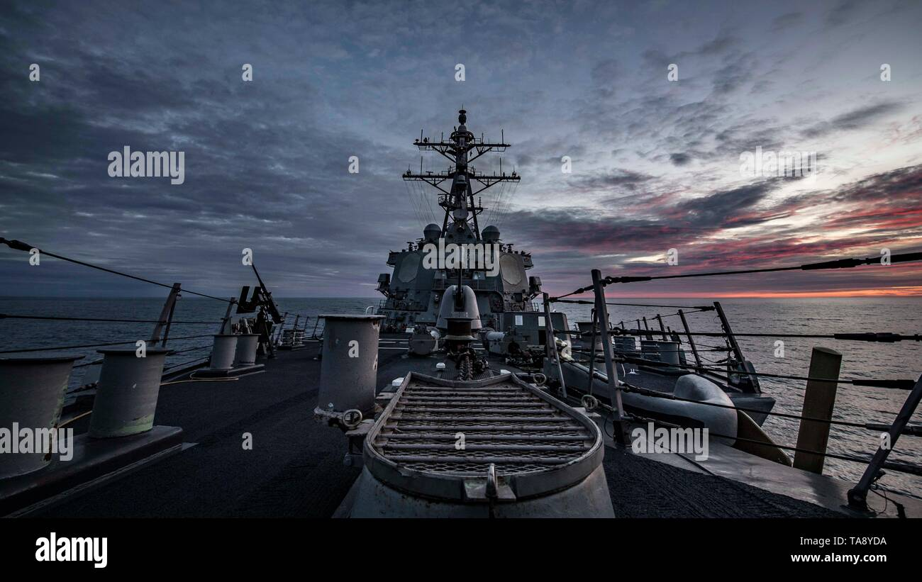 190520-N-TI693-0325    ATLANTIC OCEAN (May 20, 2019) - The Arleigh Burke-class guided-missile destroyer transits through the Atlantic Ocean, May 20, 2019. Carney, forward-deployed to Rota, Spain, is on its sixth patrol in the U.S. 6th Fleet area of operations in support of regional allies and partners as well as U.S. national security interests in Europe and Africa. (U.S. Navy photo by Mass Communication Specialist 1st Class Fred Gray IV/Released) - Stock Image