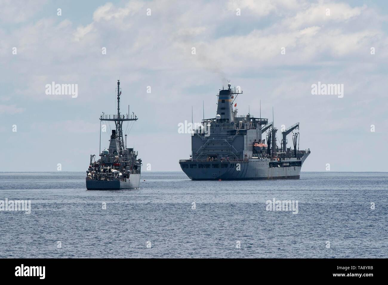 190515-N-SB587-1010 SOUTH CHINA SEA (May 15, 2019) The Avenger-class mine countermeasure ship USS Patriot (MCM 7) approaches the fleet replenishment oiler USNS Guadalupe (T-AO 200) during a replenishment-at-sea. Patriot, part of Mine Countermeasures Squadron 7, is operating in the U.S. 7th Fleet area of operations to enhance interoperability with partners and serve as a ready-response platform for contingency operations. (U.S. Navy photo by Mass Communication Specialist 2nd Class Corbin J. Shea) - Stock Image