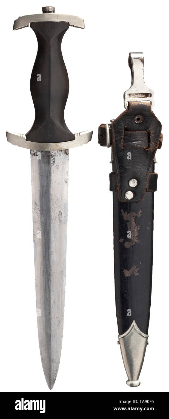 """A service dagger M 33, Carl Eickhorn, Solingen Blade with etched devices and maker's mark, the crossguard (stamped """"III"""") and pommel in nickel silver, black ebony wood grip (eagle and emblem replaced). Black painted steel scabbard (rubbed) and leather vertical hanger. Signs of usage and age. Length circa 37 cm. Included is an RZM tag of maker M7/37 no. 006328 for an SS service dagger. historic, historical, 20th century, 1930s, 1940s, Waffen-SS, armed division of the SS, armed service, armed services, NS, National Socialism, Nazism, Third Reich, German Reich, Germany, milita, Editorial-Use-Only Stock Photo"""