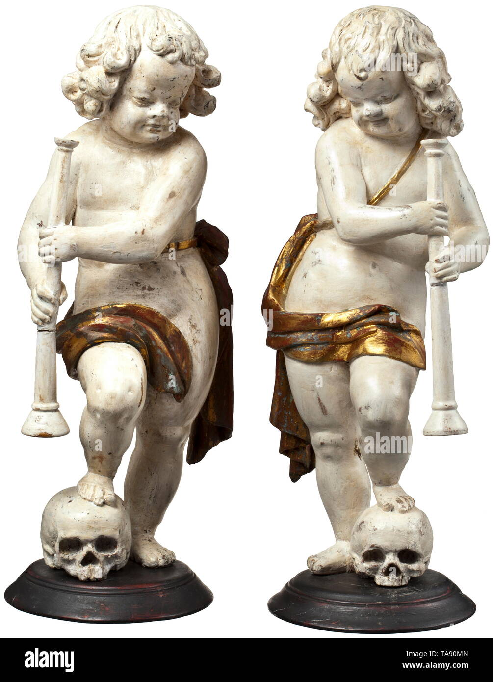 A pair of German or Flemish cherubs, circa 1700 Three-dimensional carved figures of lime wood with old paint in white and gold. Depiction of boys in loincloths, each holding a flute and with a foot resting on a skull. On a round plinth (supplemented?). Height of each 50 cm. historic, historical, fine arts, art, 18th century, Additional-Rights-Clearance-Info-Not-Available Stock Photo