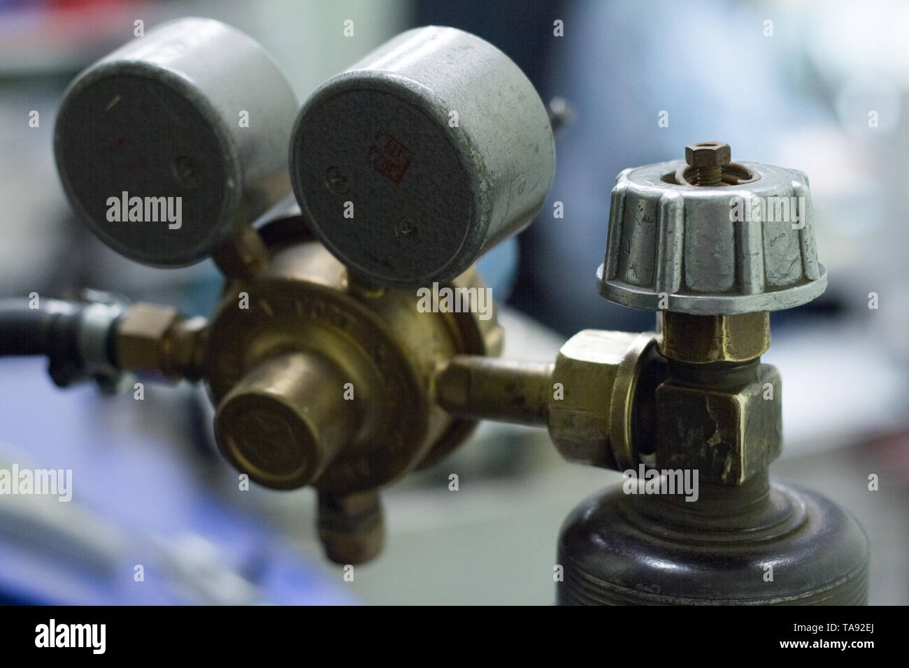Close-up of a pressure sensors on an oxygen cylinder with inscriptions in Russian - Stock Image
