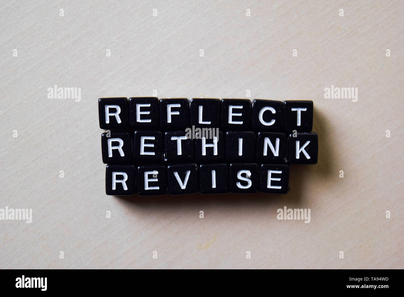 Reflect - Rethink - Revise on wooden blocks. Business and inspiration concept - Stock Image