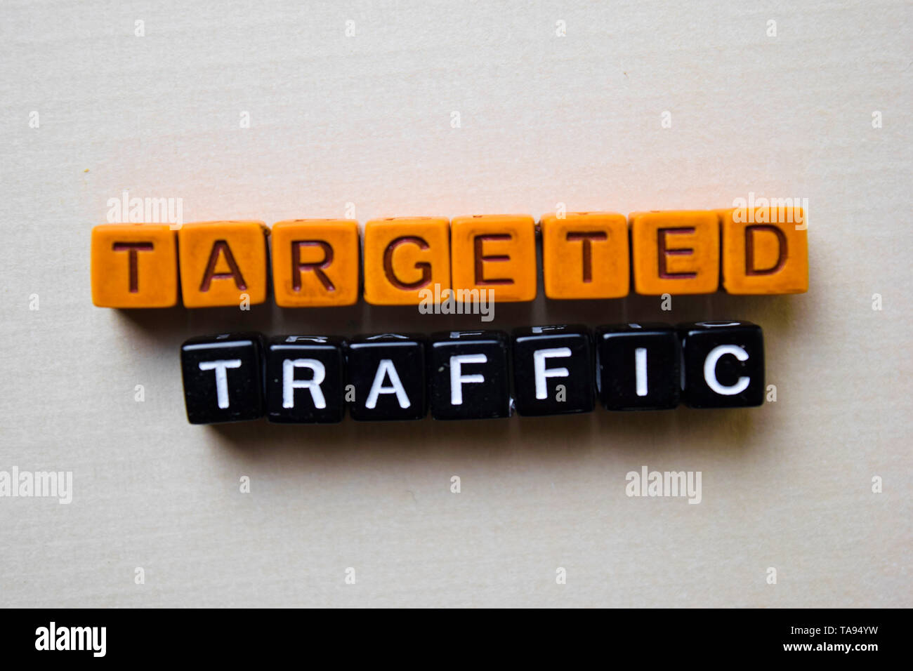 Targeted Traffic on wooden blocks. Business and inspiration concept - Stock Image