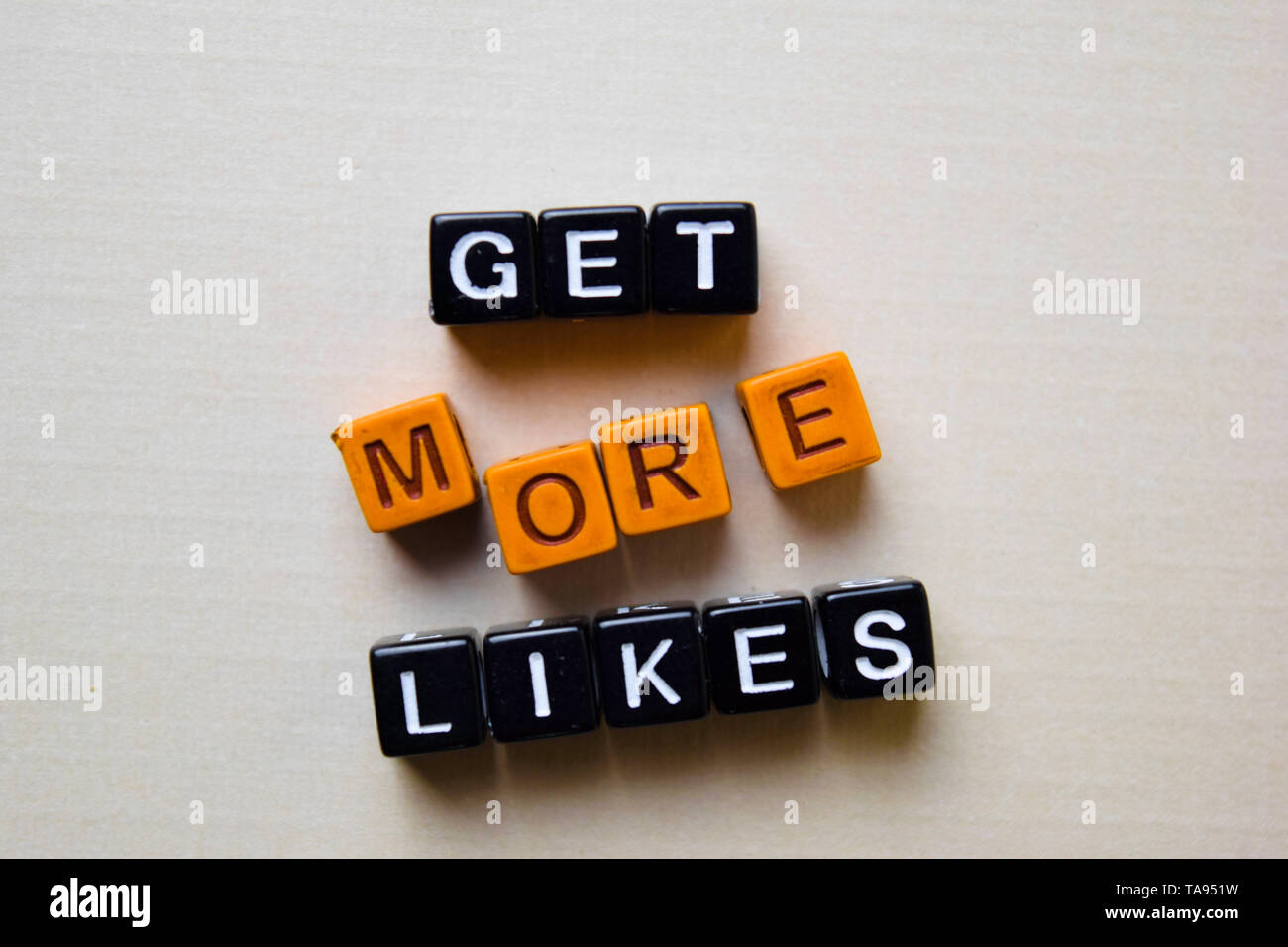 Get More Likes on wooden blocks. Business and inspiration concept - Stock Image