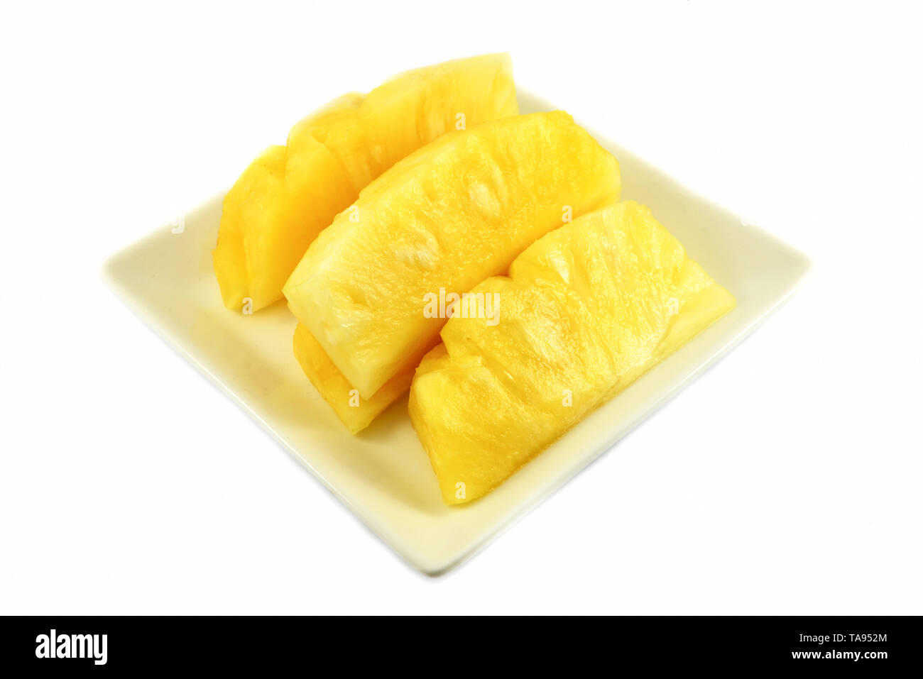 fresh pineapple isolated / sweet pineapple fruits slice isolated on white background tropical fruit on plate - Stock Image