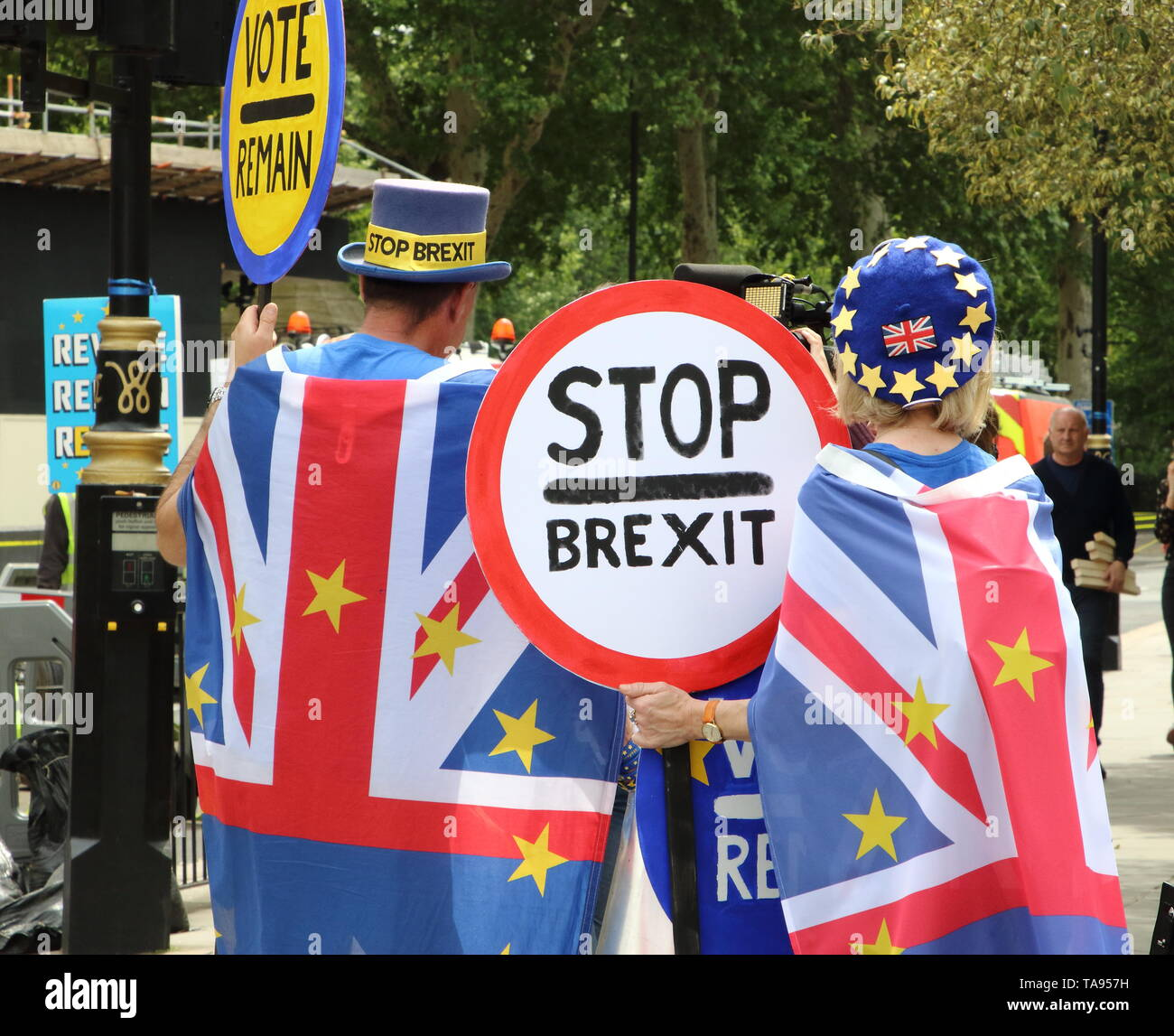 Anti-Brexit protesters seen holding European Union Flags and placard outside the Houses of Parliament in Westminster, London on the eve of the European Parliament elections. - Stock Image