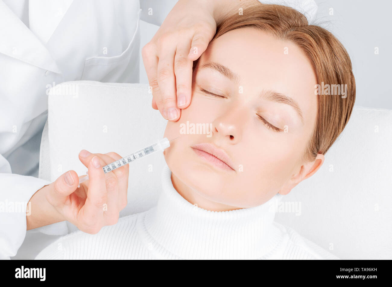 Woman Is Getting Filler Injection In Cheeks Anti Aging Treatment