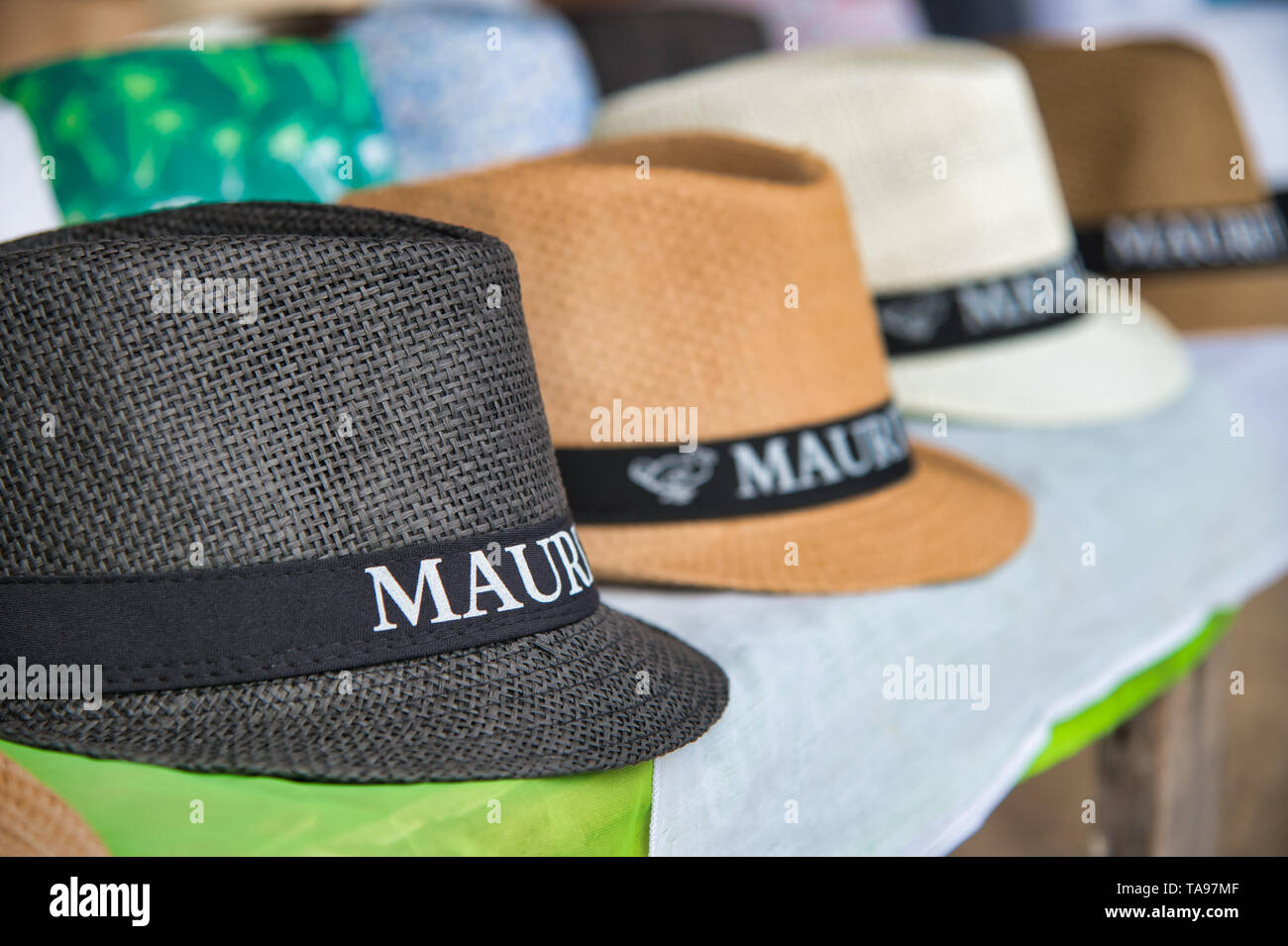 fa095d3b17b9ae MAURITIUS - MAY 2, 2019: Straw hats on sale in a tourist shop. Mauritius is  a famous tourist attraction for sea holidays.