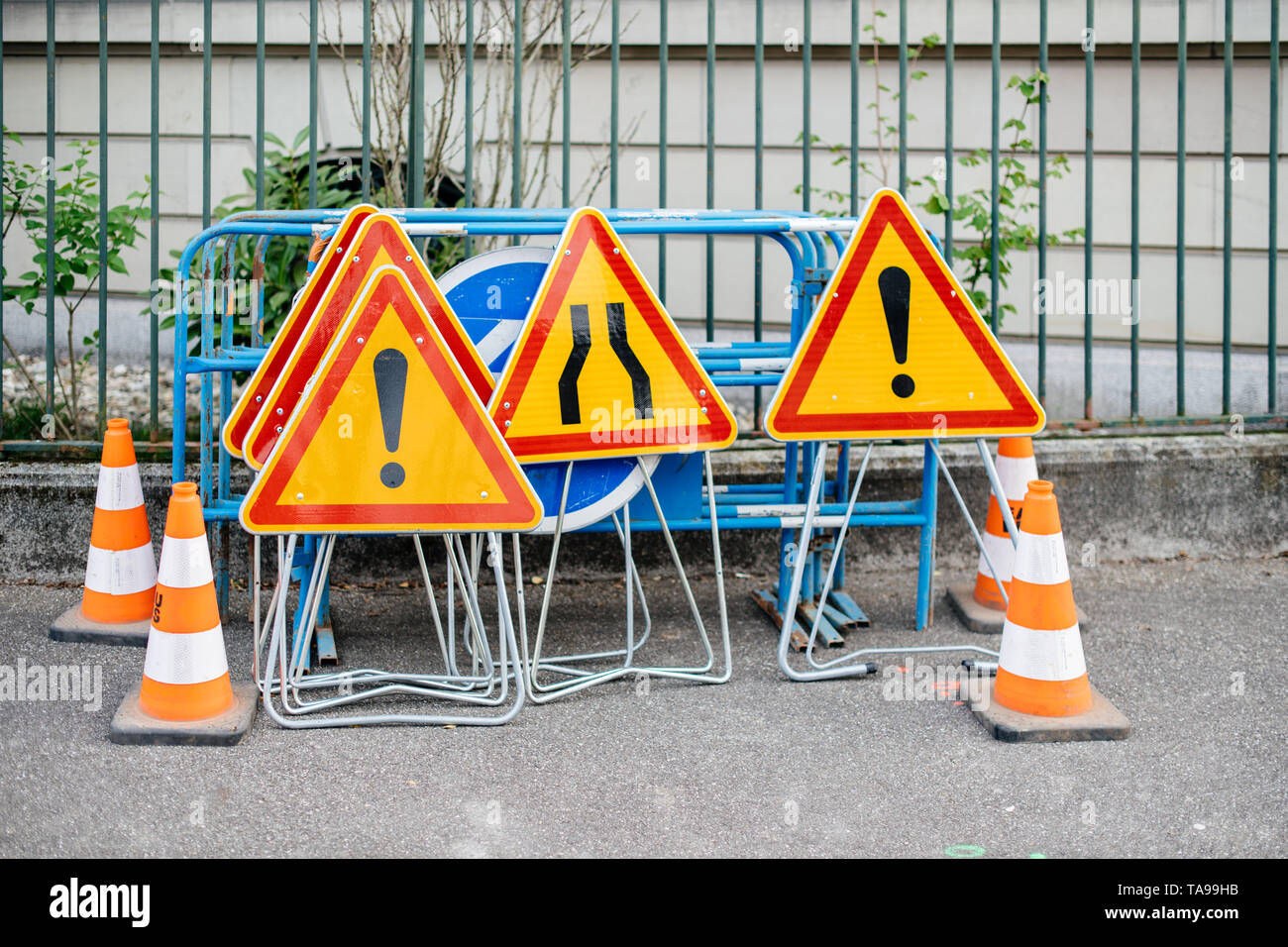 Traffic signs and cones on a street near a roadworks construction site   - Stock Image