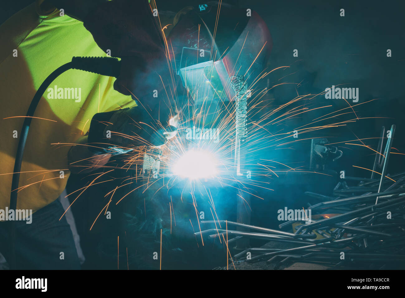 Industrial Worker at the factory or workshop welding steel elements Stock Photo