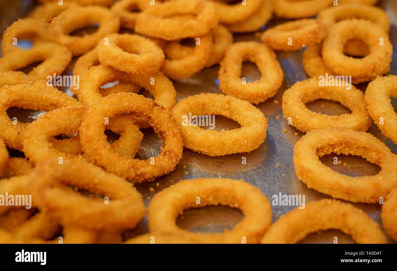 Many Crunchy Fried Onion Rings Are Ready To Service In A
