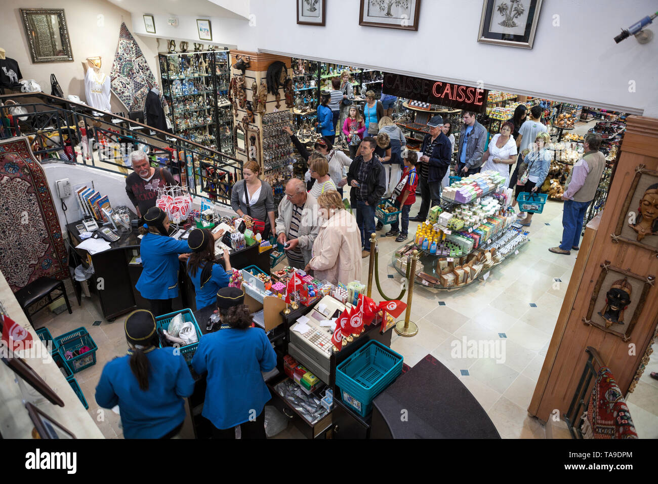 SOUSSE, TUNISIA-CIRCA MAY, 2012: Shopping area and checkout lane are in Yasmina souvenir center. Interior of large giftshop with lot of advertising gi - Stock Image