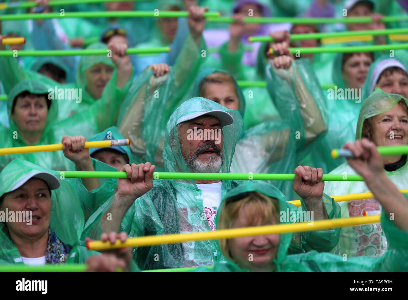 Moscow, Russia. 23rd May, 2019. MOSCOW, RUSSIA - MAY 23, 2019: Senior citizens participating in the Moscow Longevity project set a world record of 'the most populous exercise with sticks' among people of older age, at the opening of a summer season at Moscow's Muzeon Park. Sergei Savostyanov/TASS Credit: ITAR-TASS News Agency/Alamy Live News - Stock Image