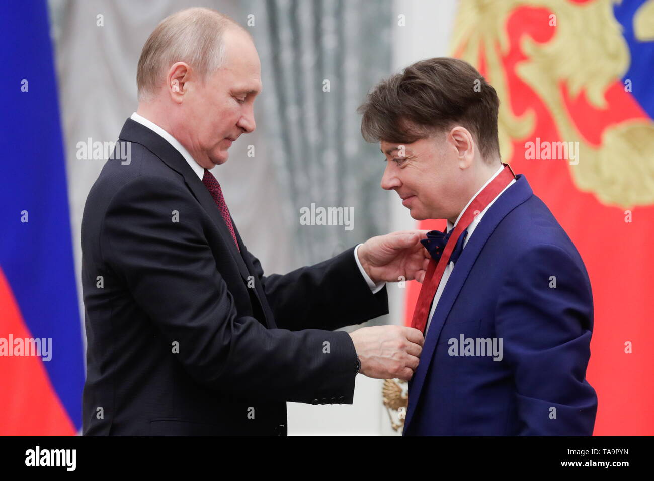 Moscow, Russia. 23rd May, 2019. MOSCOW, RUSSIA - MAY 23, 2019: Russia's President Vladimir Putin (L) and Russian fashion designer Valentin Yudashkin, awarded the Order of Merit for the Fatherland (3rd class), during a ceremony to present state decorations at Moscow's Kremlin. Mikhail Metzel/TASS Credit: ITAR-TASS News Agency/Alamy Live News - Stock Image
