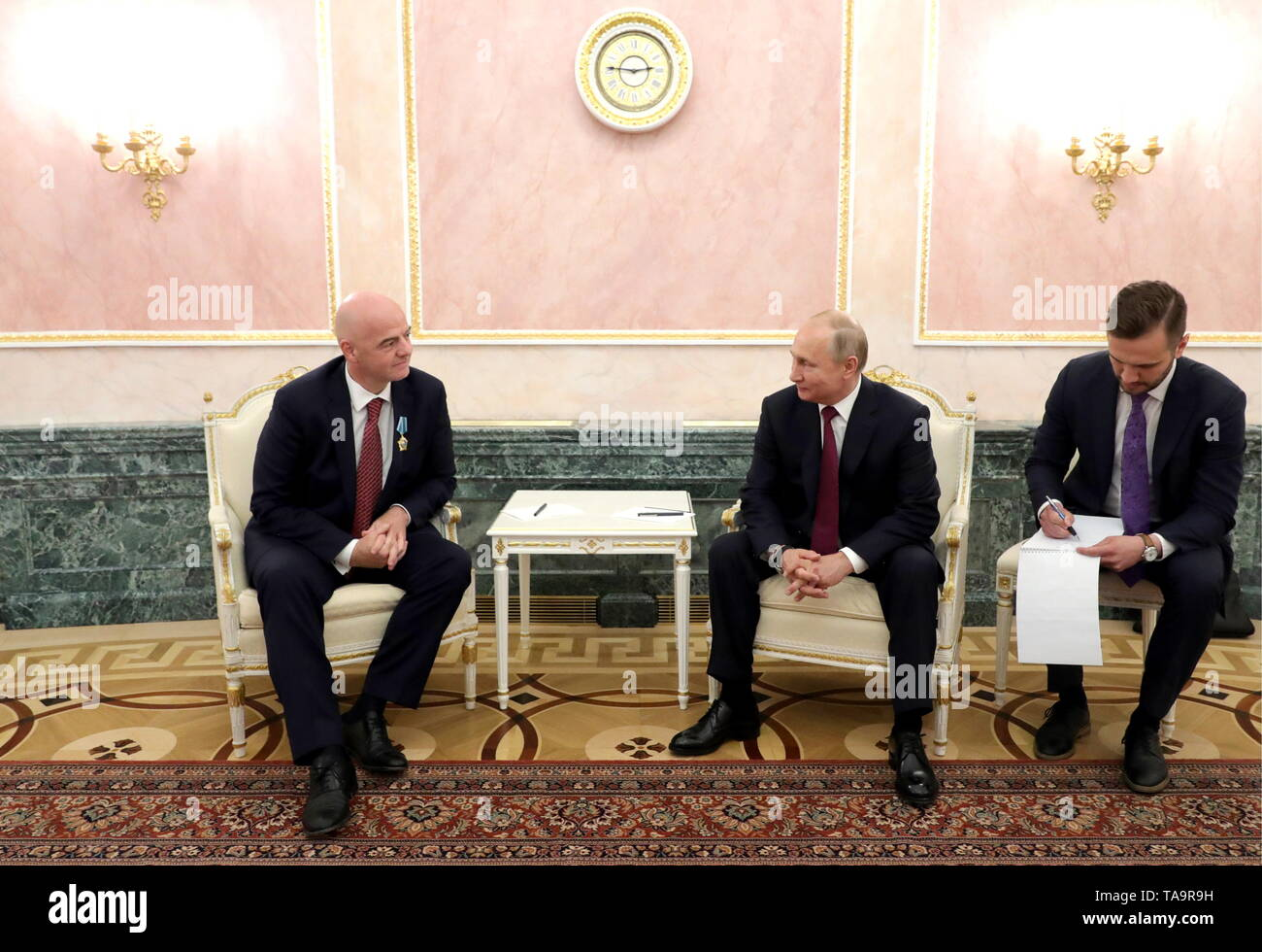 Moscow, Russia. 23rd May, 2019. MOSCOW, RUSSIA - MAY 23, 2019: FIFA President Gianni Infantino (L) and Russia's President Vladimir Putin talk during a meeting at the Moscow Kremlin. Mikhail Klimentyev/Russian Presidential Press and Information Office/TASS Credit: ITAR-TASS News Agency/Alamy Live News - Stock Image