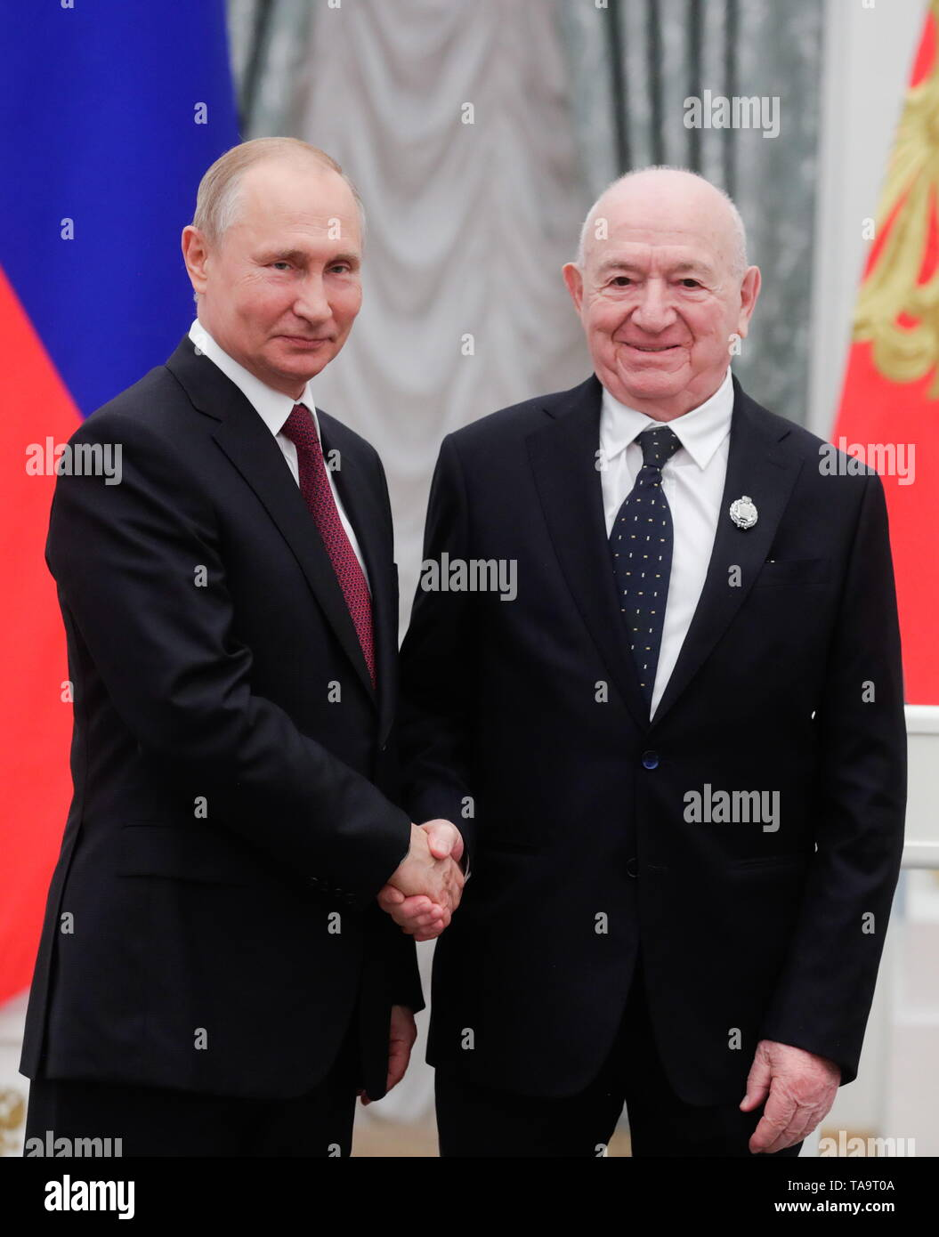 Moscow, Russia. 23rd May, 2019. MOSCOW, RUSSIA - MAY 23, 2019: Russia's President Vladimir Putin (L) awards a title of the honoured sports worker to Nikita Simonyan, First Vice President of the Russian Football Union, during a ceremony to present state decorations at the Moscow Kremlin. Mikhail Metzel/TASS Credit: ITAR-TASS News Agency/Alamy Live News - Stock Image