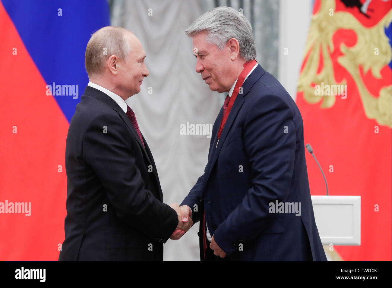 Moscow, Russia. 23rd May, 2019. ATTENTION EDITORS! IN PHOTOS TS0AC6BC, TS0AC6BD DATED MAY 23, 2019 THE CAPTION INCORRECTLY NAMED THE PERSON CORRECTED CAPTION FOLLOWS: MOSCOW, RUSSIA - MAY 23, 2019: Russia's President Vladimir Putin (L) awards an Order III class For Merit to the Fatherland to Mikhail Eskindarov, Rector of the Russian Government Financial University, during a ceremony to present state decorations at the Moscow Kremlin. Mikhail Metzel/TASS WE REGRET ANY INCONVENIENCE Credit: ITAR-TASS News Agency/Alamy Live News - Stock Image
