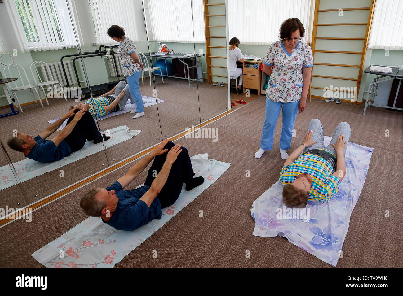 Rostov On Don, Russia. 23rd May, 2019. ROSTOV-ON-DON, RUSSIA - MAY 23, 2019: Elderly people during a therapeutic exercise session at a geriatric centre, part of a regional hospital for war veterans. Valery Matytsin/TASS Credit: ITAR-TASS News Agency/Alamy Live News - Stock Image