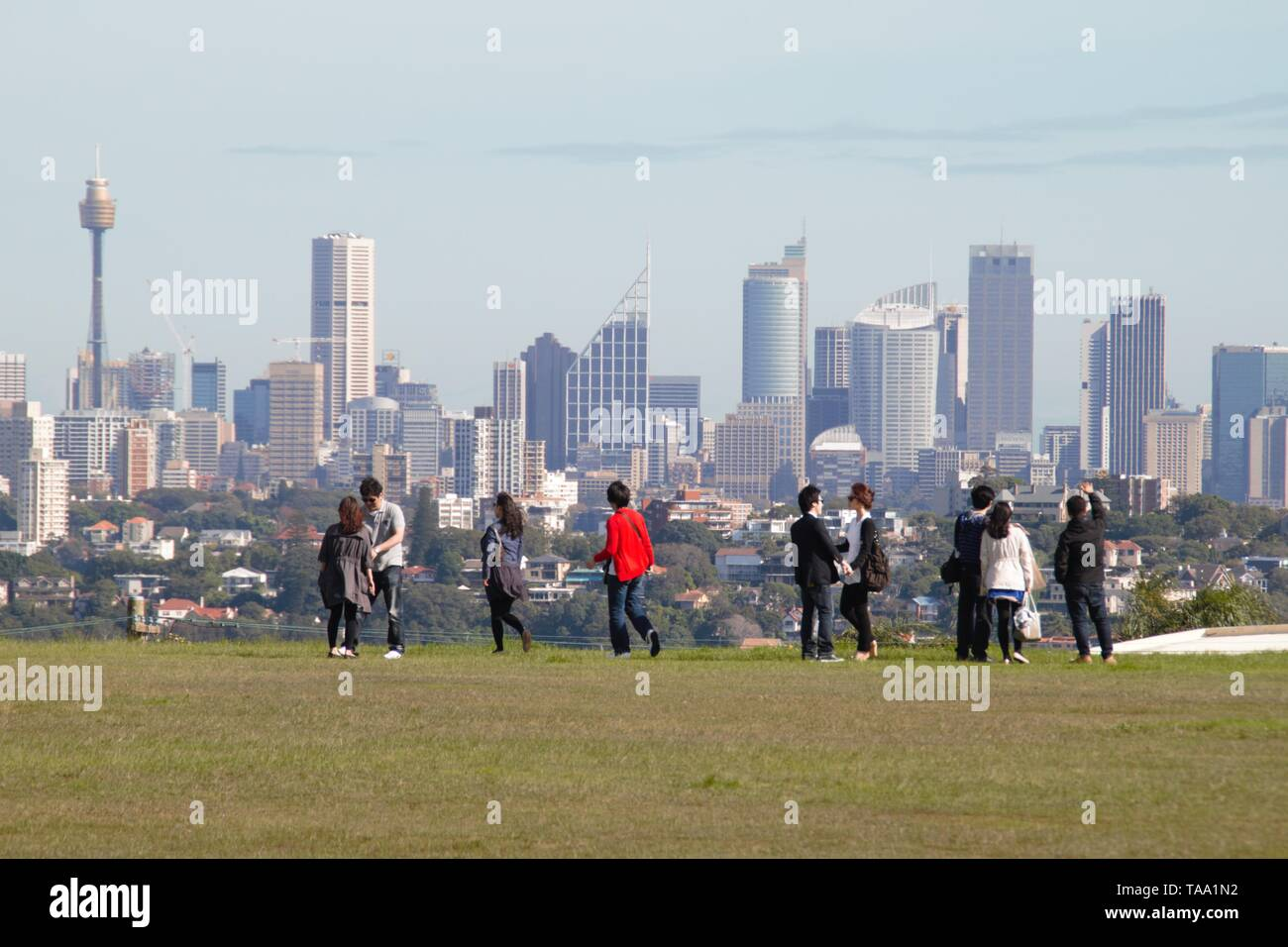 Beautiful Sydney Skyline from the park with tourists in front of the picture - Stock Image