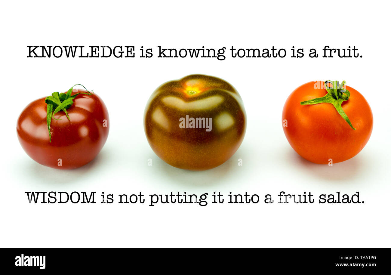 Three colorful organic tomatoes and a clever saying about waht we know and how to apply it. - Stock Image